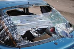 Car window smashed by a thief Royalty Free Stock Photography