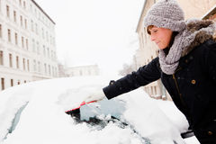 Car window snow removing Royalty Free Stock Photo