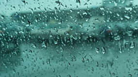 Car window under the rain with droplets close up stock video