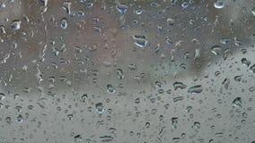 Car window under the rain stock footage