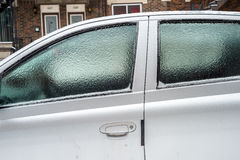 Car windows are covered with ice after freezing rain. Stock Photography