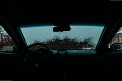 Car Windshield thawed. Snow Thawing On A Windshield Of A Car Royalty Free Stock Photos