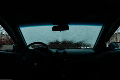 Car Windshield thawed. Snow Thawing On A Windshield Of A Car Royalty Free Stock Photography
