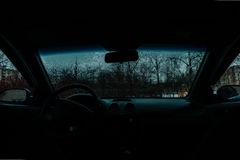 Car Windshield thawed. Snow Thawing On A Windshield Of A Car Stock Images