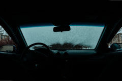 Car Windshield thawed. Snow Thawing On A Windshield Of A Car Stock Photo