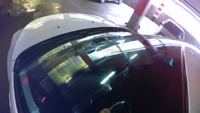 Car windshield. Underground Parking lights reflected in windshield. Camera on board. stock video footage