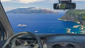 Car windshield view of Sorrento Peninsula from Capri, Naples, It. Looking through a car windshield with view of the beautiful Sorrento Peninsula seen from Capri royalty free stock photo