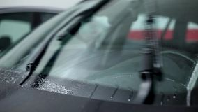 Car windshield wipers in action stock video
