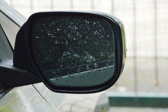 Car wing mirror with lot water drop make poor visibility for driving Stock Images