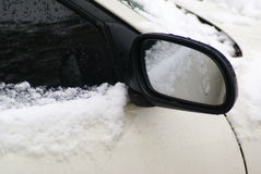 Car wing mirror with snow. Car wing mirror covered with snow Royalty Free Stock Photo