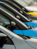 Car wingmirrors on display on dealers forecourt. Vehicles for sale parked in a row with close up detail on the wing mirror without focus on any particular model Royalty Free Stock Photography