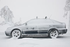 Car in winter. Skoda Octavia car covered with snow royalty free stock photography