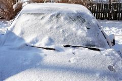 Car In Winter. Winter country landscape. Closeup frozen car under snow Stock Photos