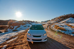 Car in winter desert Stock Photo