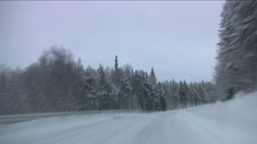 Car on winter forest road. Car quickly goes on winter forest road. Twilight. Finland. Timelapse stock video footage
