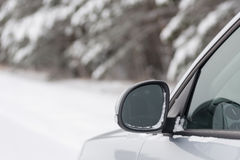 Car in winter forest Stock Photos