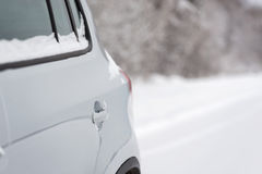 Car in winter forest Stock Image