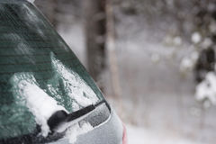Car in winter forest Stock Photo