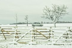 Car in winter landscape stock photos