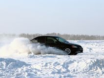 Car on winter road. Stock Photography