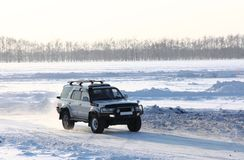 Car on winter road. royalty free stock image