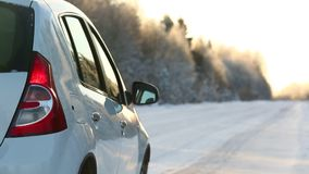 Car on the winter road stock video footage