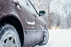 Car on winter road covered with snow Stock Photo