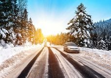 Car on the winter road. Defocused car on the winter road in the mountains royalty free stock image