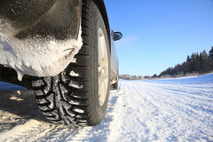 Car on winter road stock photography