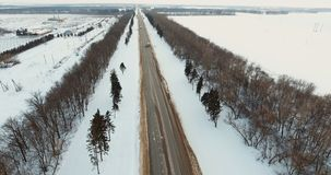 Car on winter road. Winter landscape. Car driving on icy road. Winter forest, field. Aerial view: Winter landscape countryside, forest, field stock video