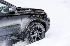 Car in the winter snowdrifts Royalty Free Stock Images