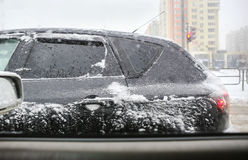 Car in the winter on the street in snowstorm Stock Photos
