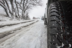 Car with winter tire. S on a mountain road stock photography