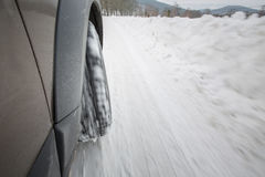 Car with winter tires on a slippery, snowy road Royalty Free Stock Images