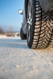 Car with winter tires on a snowy road Royalty Free Stock Photos