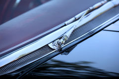 Car wiper. Shiny chrome coated wiper of a classic car Royalty Free Stock Photos