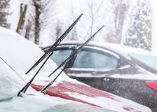 Car wiper blades in winter royalty free stock photo