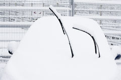 Car and wiper under snow Royalty Free Stock Photos