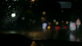 Car wipers at day and night stock video footage