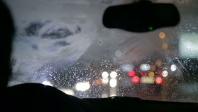 Car wipers at day and night stock footage