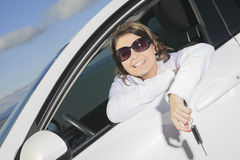Car. Woman driver happy smiling. A woman driver happy holding a key Stock Photography