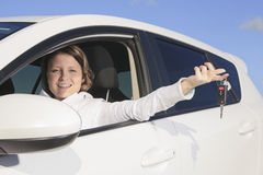 Car. Woman driver happy smiling. A woman driver happy holding a key Stock Photo