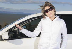 Car. Woman driver happy smiling. A woman driver happy holding a key Royalty Free Stock Photos