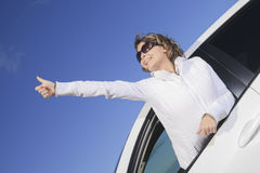 Car. Woman driver happy smiling. A positive thumb up woman with is white car Royalty Free Stock Image
