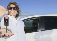 Car. Woman driver happy smiling. A woman driver happy to receive a key Royalty Free Stock Photo
