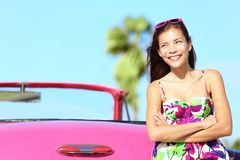 Car woman happy. Smiling by pink vintage car. Beautiful young multiracial female driver in Havana, Cuba Royalty Free Stock Photography