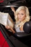 Car woman map looking Royalty Free Stock Image