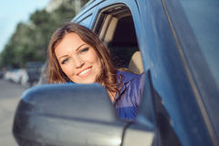 Car woman on road trip Royalty Free Stock Image