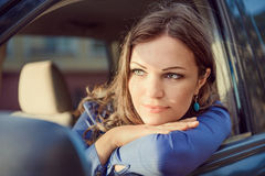 Car woman on road trip looking out of window. Having rest on sun Royalty Free Stock Photo