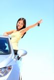 Car woman showing car keys. Car. Woman driver showing car keys smiling happy in her new car. Beautiful young multiracial Caucasian / Chinese Asian female driver royalty free stock photo